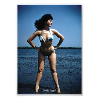 Bettie Page in a Blue Bikini Standing Beside Water Photograph