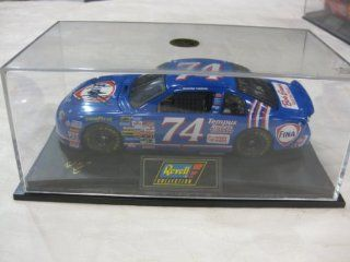 Nascar Die cast #74 Randy LaJoie FINA / Bob Evans Racing Team Edition Chevy Monte Carlo Series Collector's Model Car with An Encased Display Stand in a 124 Scale Manufactured by Revell Collection Toys & Games