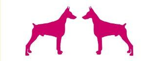 Two opposing silhouettes of a DOBERMAN PINSCHER vinyl decal available in 4 & 6 inch sizes and many colors
