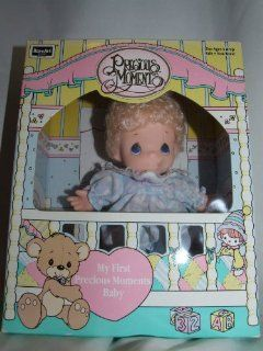 1992 Rose Art Industries, Inc. 1992 PMC, Inc. Rose Art Precious Moments My First Precious Moments Baby 10400/10000 ASST. w/contents of 6 Inch Vinyl Doll, Combable Hair, Removable Clothing and Surfece washable Clothing